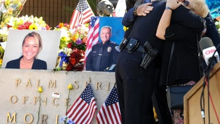 Memorial for Palm Springs Police Officers Jose Gilbert Vega and Lesley Zerebny who were killed last week. [Photo from Associated Press through foxnews.com]