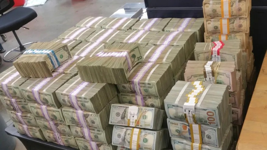 This undated photo provided by U.S. Customs and Border Protection shows cash seized by the U.S. Border Patrol who says it's seized more than $3 million that was being smuggled from the U.S. into Mexico.