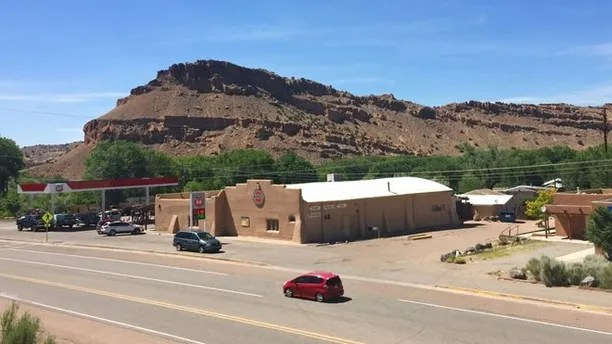 The view of a general store parking lot in Abiquiu, N.M., on Friday, June 16, 2017, where a rampaging gunman shot and killed a 59-year-old Manuel Serrano the day before. A shooting spree linked to a lone gunman spanned 200 miles across northern New Mexico, killed four and ended with the arrest of suspect Damian Herrera. Abiquiu was once home to artist Georgia O'Keeffe. (AP Photo/Morgan Lee)