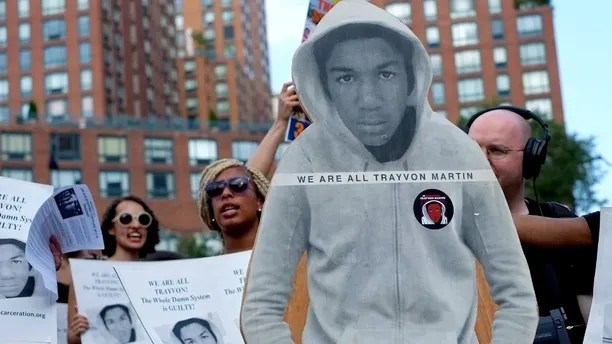 Activists on Union Square stand with a cut out photo of Trayvon Martin, Sunday, July 14, 2013, in New York, during a protest against the acquittal of volunteer neighborhood watch member George Zimmerman in the 2012 killing of 17-year-old Trayvon Martin in Sanford, Fla. Demonstrators upset with the verdict protested mostly peacefully in Florida, Milwaukee, Washington, Atlanta and other cities. (AP Photo/Craig Ruttle)