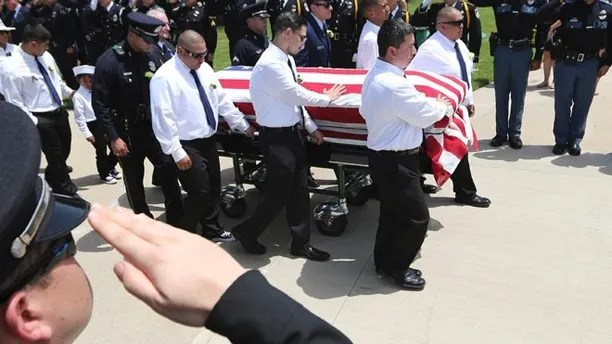 Pallbearers lead the flag draped coffin of slain Dallas police officer Patrick Zamarripa into place for an honor guard ceremony at Dallas-Fort Worth National Cemetery in Dallas, Saturday, July 16, 2016. Zamarripa was one of five officers killed last week by a lone gunman during a protest march in Dallas. (AP Photo/LM Otero)