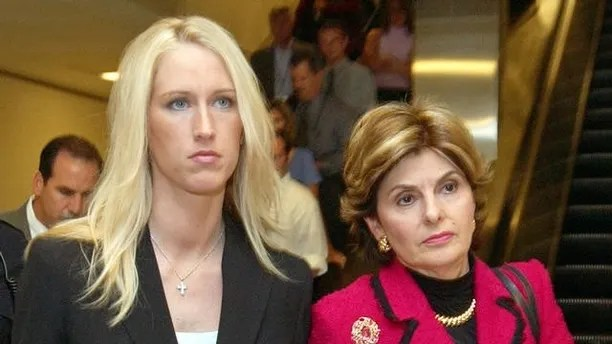 Amber Frey, left, leaves with her attorney Gloria Allred, right, after she testified during the Scott Peterson trial at the Redwood City, Calif., courthouse, Tuesday, Aug. 10, 2004. Peterson is the Modesto, Calif., man who could face the death penalty for the murder of his wife, Laci Peterson, and their unborn son. (AP Photo/Paul Sakuma, pool)