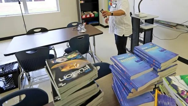 HISD Superintendent Richard Carranza walks through a classroom damaged by floodwaters at A.G. Hilliard Elementary School in the aftermath of Hurricane Harvey Saturday, Sept. 2, 2017, in Houston. (AP Photo/David J. Phillip)