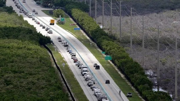 Motorists head north on US 1, Wednesday, Sept. 6, 2017, in Key Largo, Fla., in anticipation of Hurricane Irma.  Keys officials announced a mandatory evacuation Wednesday for visitors, with residents being told to leave the next day. (AP Photo/Alan Diaz)