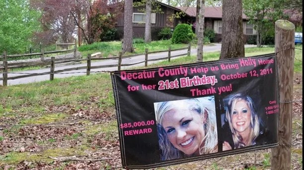 FILE - In this April 19, 2013 file photo, a poster with pictures of missing Tennessee nursing student Holly Bobo hangs on a fence in front of her house in Parsons, Tenn. The Tennessee Bureau of Investigation is holding a news conference Wednesday afternoon, March 5, 2014, to update the public about the disappearance of Bobo nearly three years ago. (AP Photos/Adrian Sainz, File)