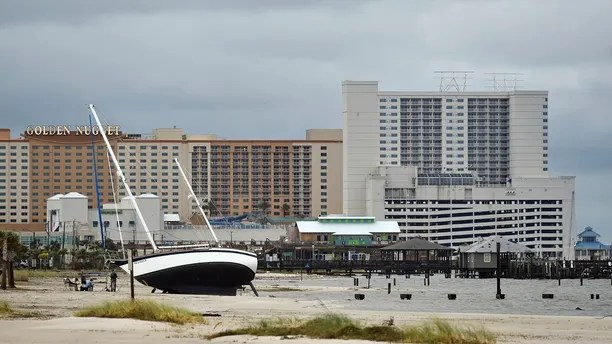 A sail boat is beached near Margaritaville and the Golden Nugget in Biloxi, Miss., Sunday, Oct. 8, 2017, after Hurricane Nate made landfall on the Gulf Coast.  (Justin Sellers/The Clarion-Ledger via AP)