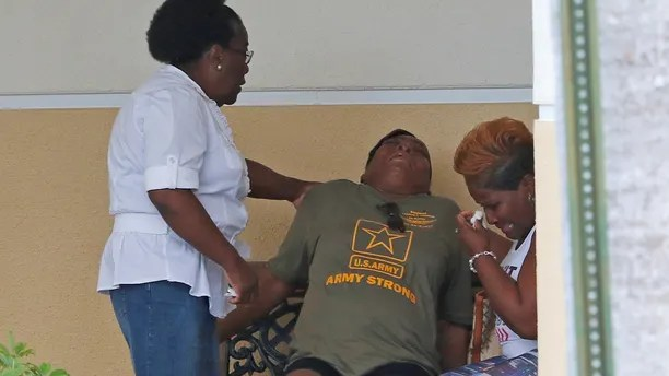 Sharon Wright (C) is aided by family after at the viewing of U.S. Army Sergeant La David Johnson, who was among four special forces soldiers killed in Niger, at Christ The Rock Church in Cooper City, Florida, October 20, 2017.  REUTERS/Joe Skipper - RC1EAFB6C6F0