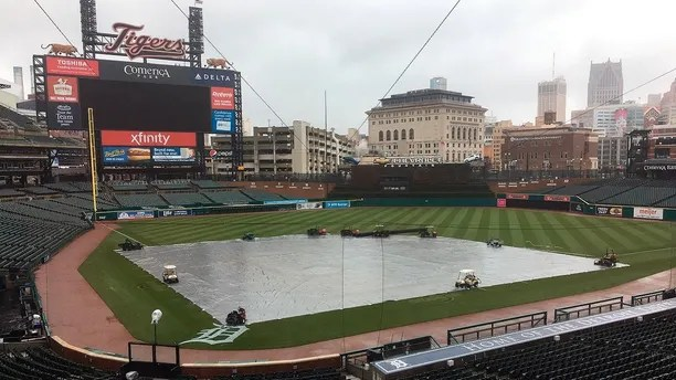 The field is covered as the Yankees and Tigers were rained out Saturday, April 14, 2018 in Detroit.  The Yankees beat the Tigers 8-6 on Friday night, and the teams will try to play a split doubleheader Sunday to finish this three-game series — but the weather then might not be any better.  (AP Photo/Noah Trister)