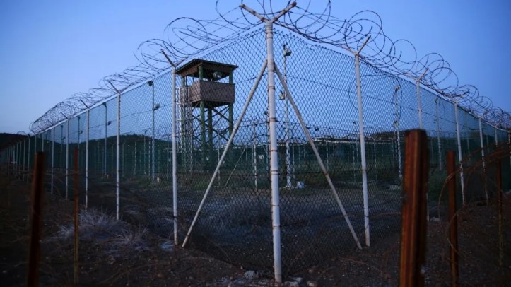 Chain link fence and concertina wire surround a deserted guard tower within Joint Task Force Guantanamo's Camp Delta at the U.S. Naval Base in Guantanamo Bay, Cuba, March 21, 2016.