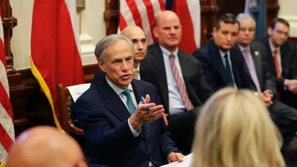 Texas Gov. Gregg Abbott, left, hosts a roundtable discussion in Austin, Texas, Thursday, May 24, 2018, to address safety and security at Texas schools in the wake of the shooting at Santa Fe, Texas. Thursday's roundtable included victims, students, families and educators from the Santa Fe, Alpine and Sutherland Springs communities. (AP Photo/Eric Gay)
