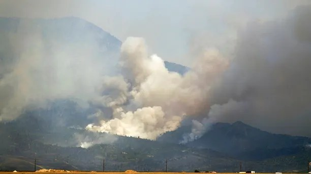 The Spring Creek Fire continues to burn in Costilla County on Tuesday, July 3, 2018 in La Veta, Colo. More than 100 homes in the Colorado mountains were destroyed by a growing wildfire, while hundreds of others across the parched U.S. West remained under evacuations Tuesday and the closure of recreation areas derailed holiday plans.  (Helen H. Richardson/The Denver Post via AP)