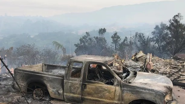 This early Saturday, July 7, 2018, photo provided by the Santa Barbara County Fire Department shows the damage to vehicles and buildings off Fairview Ave., in Goleta, Calif. In heat-stricken Southern California, powerful winds that sent an overnight inferno hopscotching through the Santa Barbara County community of Goleta vanished in the morning, allowing firefighters to extinguish smoldering ruins of an estimated 20 structures, including homes. (Mike Eliason/Santa Barbara County Fire Department via AP)