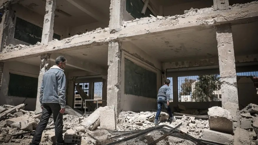 A school destroyed in fighting east of Damascus Monday.