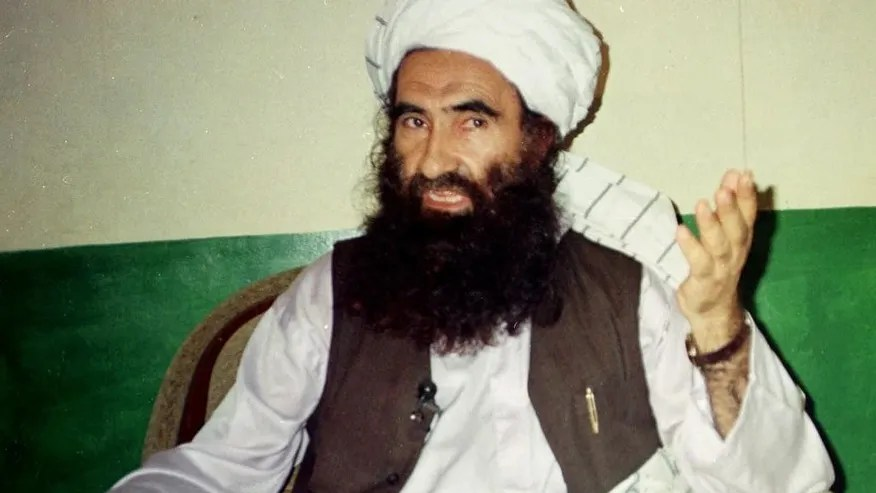 FILE- In this Aug. 22, 1998 file photo, Jalaluddin Haqqani, founder of the militant group the Haqqani network, speaks during an interview in Miram Shah, Pakistan. A shadowy, Pakistan-based militant faction is on the rise within the Taliban, moving to unify the insurgency and further poison already frayed relations between Afghanistan and its neighbor, according to analysts. An audio recording of a recent meeting of the top Taliban leadership shows the Haqqani network _ a U.S.-designated terrorist organization that was linked to a Kabul bombing last month that killed 64 people _ is on the ascendancy, raising fears that Afghanistan faces another summer of fierce fighting. (AP Photo/Mohammed Riaz, File)