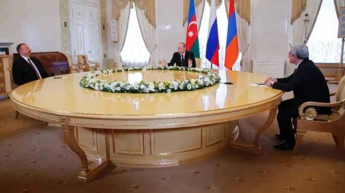 Russian President Vladimir Putin, center, meets with Azerbaijan's President Ilham Aliyev, left, and Armenian President Serzh Sargsyan in St. Petersburg, Russia, Monday, June 20, 2016. (AP Photo/Dmitry Lovetsky, pool)