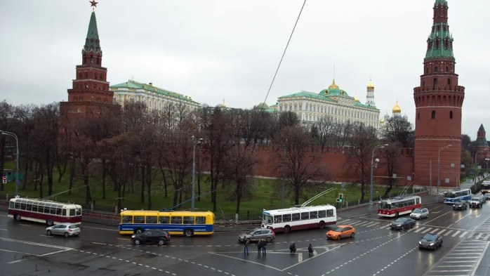 Vintage trolleybuses parade around the Kremlin in Moscow, Russia.