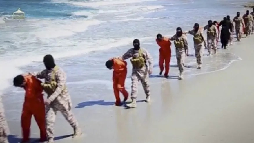 Islamic State militants lead what are said to be Ethiopian Christians along a beach in Wilayat Barqa, in this still image from an undated video made available on a social media website on April 19, 2015.
