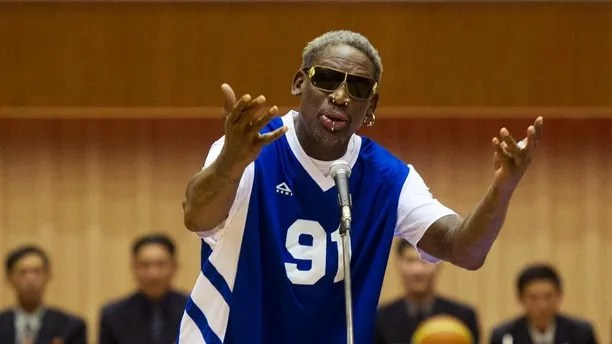 "FILE - In this Jan. 8, 2014 file photo, former NBA star Dennis Rodman sings ""Happy Birthday"" to North Korean leader Kim Jong Un, seated above in the stands, before an exhibition basketball game at an indoor stadium in Pyongyang, North Korea. North Korea marked Kim Jong Un's birthday on Sunday, Jan. 8, 2017, in a decidedly low-key manner. Kim, who is believed to be 33 or 34 and the world's youngest head of state, assumed power after the death of his father, Kim Jong Il, in late 2011. (AP Photo/Kim Kwang Hyon, File)"