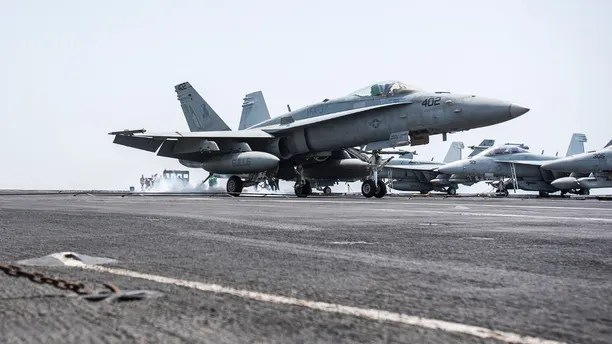 "170411-N-YL257-028 ARABIAN GULF (April 11, 2017) An F/A-18C Hornet attached to the ""Ragin' Bulls"" of Strike Fighter Squadron (VFA) 37 lands on the flight deck of the aircraft carrier USS George H.W. Bush (CVN 77) (GHWB). GHWB is deployed in the U.S. 5th Fleet area of operations in support of maritime security operations designed to reassure allies and partners, and preserve the freedom of navigation and the free flow of commerce in the region. (U.S. Navy photo by Mass Communication Specialist 3rd Class Christopher Gaines/Released)"