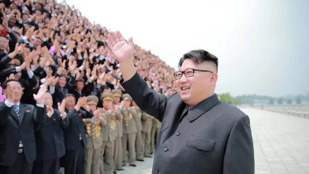 North Korean leader Kim Jong Un waves as he participates in a photo session with officials who are committed to the success of the test-fire of surface-to-surface medium long-range strategic ballistic missile Hwasong-10, in this undated photo released by North Korea's Korean Central News Agency (KCNA) June 28, 2016. REUTERS/KCNA ATTENTION EDITORS - THIS PICTURE WAS PROVIDED BY A THIRD PARTY. REUTERS IS UNABLE TO INDEPENDENTLY VERIFY THE AUTHENTICITY, CONTENT, LOCATION OR DATE OF THIS IMAGE. FOR EDITORIAL USE ONLY. NO THIRD PARTY SALES. SOUTH KOREA OUT. THIS PICTURE IS DISTRIBUTED EXACTLY AS RECEIVED BY REUTERS, AS A SERVICE TO CLIENTS.      TPX IMAGES OF THE DAY      - RTX2IOVD