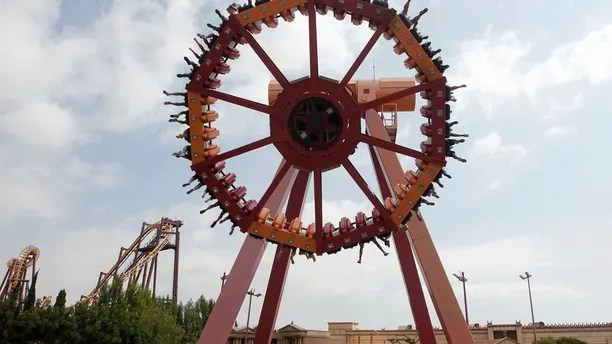 People ride an attraction in the Terra Mitica theme park in the coastal town of Benidorm in south-eastern Spain, August 6, 2014. Spain registered its fastest economic growth since before the financial crisis in the second quarter, becoming one of the brightest spot in a struggling euro zone, though a sharp fall in consumer prices showed the economy faced risks. Wednesday's preliminary National Statistics Institute (INE) reading of 0.6 percent was the strongest quarter on quarter rise since the final months of 2007 and beat economists' forecasts of 0.5 percent. It compared growth of 0.4 percent in the previous three months. REUTERS/Heino Kalis  (SPAIN - Tags: SOCIETY) - RTR41GIW