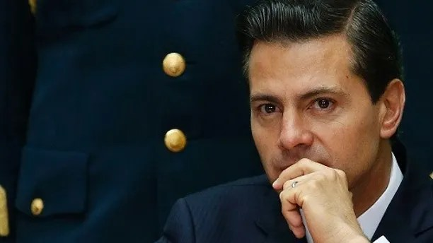 Mexico's President Enrique Pena Nieto attends the International Financial Inclusion Forum at the National Palace in Mexico City, Thursday, Sept. 7, 2017. (AP Photo/Marco Ugarte)