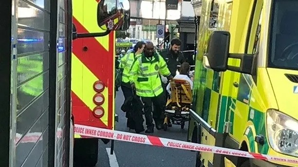 Emergency personnel attend to a person after an incident at Parsons Green underground station in London, Britain, September 15, 2017.  REUTERS/Yann Tessier - RC13970D6A00