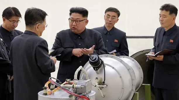 FILE - This undated file photo distributed by the North Korean government shows North Korean leader Kim Jong Un, center, at an undisclosed location in North Korea. The world is wondering if North Korea's next nuclear test will involve a nuclear missile screaming over Japan after the North said it may test a hydrogen bomb in the Pacific Ocean. Independent journalists were not given access to cover the event depicted in this image distributed by the Korean Central News Agency via Korea News Service. The content of this image is as provided and cannot be independently verified. (Korean Central News Agency/Korea News Service via AP, File)