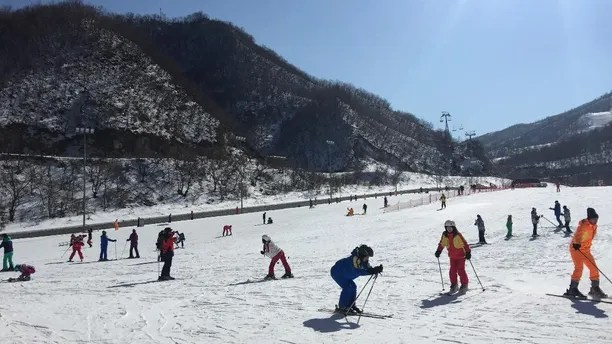 "In this Saturday Feb. 11, 2017, photo, North Koreans ski at the Masik Pass Ski Resort in Wonsan, North Korea. North Korea's Olympic committee lashed out Monday, Feb. 13, 2017, against sanctions over its nuclear and long-range missile programs, claiming they are aimed at hurting the North's efforts to compete in international sports. Sanctions that block the sale of such items as skis, snowmobiles, snow groomers, yachts and even billiard tables are a ""vicious ulterior political scheme,"" according to its National Olympic Committee. (AP Photo/Wong Maye-E)"