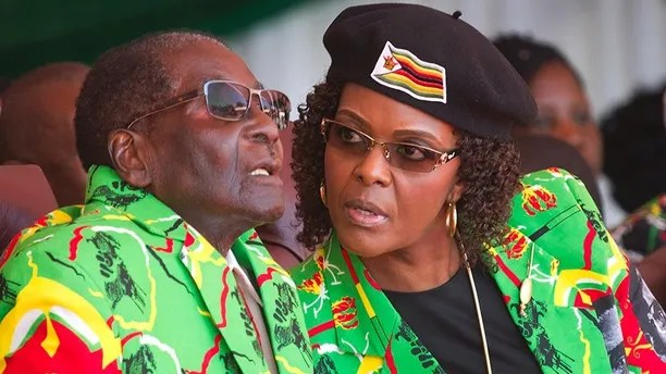 FILE - In this June, 2, 2017 file photo Zimbabwean President Robert Mugabe, left, and his wife Grace follow proceedings during a youth rally in Marondera Zimbabwe. (AP Photo/Tsvangirayi Mukwazhi, File)