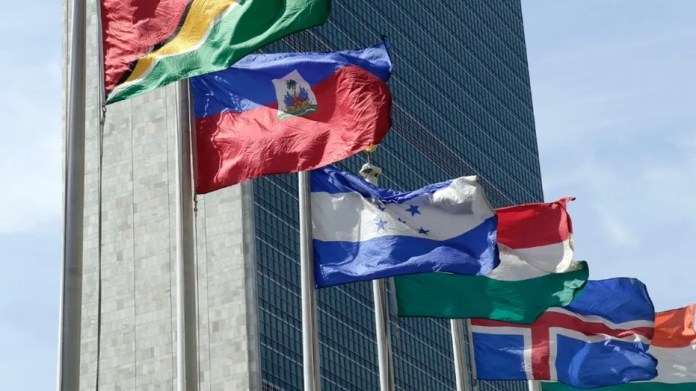FILE - In this June 1, 2016, file photo, flags of some of the 193 countries fly in the breeze in front of the Secretariat building of the United Nations.