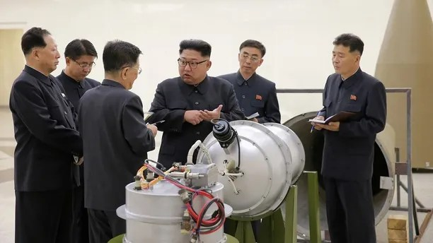 REFILE - ADDITIONAL INFORMATION   North Korean leader Kim Jong Un provides guidance with Ri Hong Sop (3rd L) and Hong Sung Mu (L) on a nuclear weapons program in this undated photo released by North Korea's Korean Central News Agency (KCNA) in Pyongyang September 3, 2017.  KCNA via REUTERS    ATTENTION EDITORS - THIS PICTURE WAS PROVIDED BY A THIRD PARTY. REUTERS IS UNABLE TO INDEPENDENTLY VERIFY THE AUTHENTICITY, CONTENT, LOCATION OR DATE OF THIS IMAGE.  NOT FOR SALE FOR MARKETING OR ADVERTISING CAMPAIGNS. NO THIRD PARTY SALES. NOT FOR USE BY REUTERS THIRD PARTY DISTRIBUTORS. SOUTH KOREA OUT. NO COMMERCIAL OR EDITORIAL SALES IN SOUTH KOREA. THIS PICTURE IS DISTRIBUTED EXACTLY AS RECEIVED BY REUTERS, AS A SERVICE TO CLIENTS. - RC1CF51FC950