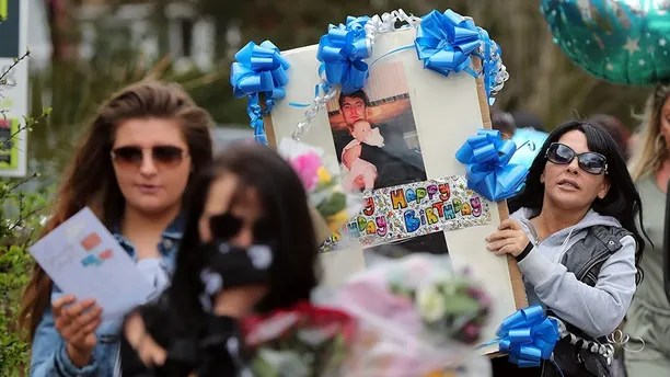 April 15, 2018 - London, UK - Friends and relatives of Henry Vincent arrive at the scene on South Park Crescent in Hither Green, London, following last week's incident where Vincent was fatally stabbed in botched burglary at the home of Mr Osborn-Brooks. (Credit Image: © Gareth Fuller/PA Wire via ZUMA Press)
