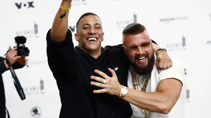 German rappers Kollegah, right, and Farid Bang pose upon arrival for the 2018 Echo Music Award ceremony.