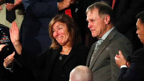 American student Otto Warmbier's parents Fred and Cindy Warmbier cry as U.S. President Donald Trump talks about the death of their son after his arrest in North Korea during the State of the Union address to a joint session of the U.S. Congress on Capitol Hill in Washington, U.S. January 30, 2018. REUTERS/Leah Millis - HP1EE1V0ANI1F