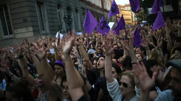 People lift up their arms as the shout slogans during a protest outside the Justice Ministry in Madrid, Thursday, April 26, 2018. Women's rights groups protested Thursday after a court in northern Spain sentenced five men to nine years each in prison for the lesser crime of sexual abuse in what activists saw as a gang rape during the 2016 running of the bulls festival in Pamplona. (AP Photo/Francisco Seco)