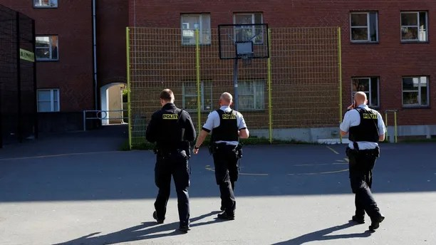 """Police patrol the grounds in Mjolnerparken, a housing estate that features on the Danish government's """"Ghetto List"""", in Copenhagen, Denmark, May 2, 2018. REUTERS/Andrew Kelly SEARCH """"DENMARK GHETTO"""" FOR THIS STORY. SEARCH """"WIDER IMAGE"""" FOR ALL STORIES. THE IMAGES SHOULD ONLY BE USED TOGETHER WITH THE STORY - NO STAND-ALONE USES. - RC13B490AB80"""