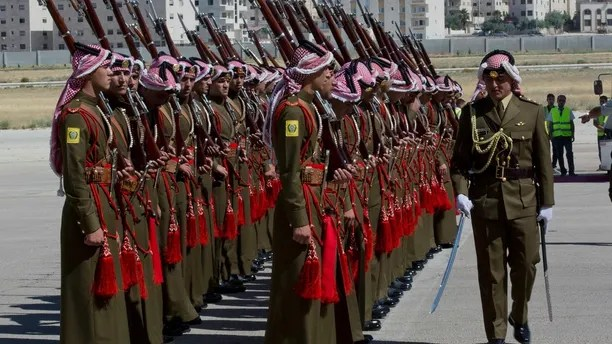 A Jordanian army officer inspects the honor guard in preparation for the arrival of British Prince William at Marka Airport in Amman, Jordan, Sunday, June 24, 2018. Britain's Prince William launched a politically delicate five-day tour of Jordan, Israel and the Palestinian territories. He plans to meet young people, refugees and political leaders in a turbulent region that Britain had controlled between the two world wars. (AP Photo / Nasser Nasser)