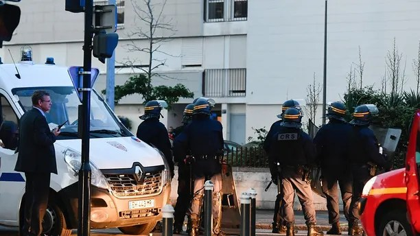 French riot police officers patrol in Nantes, western France, Tuesday July 3, 2018.  French authorities called for calm in France's western city of Nantes after scuffles with police broke out overnight, after police shot at a young driver who was trying to avoid a control.(AP Photo/Franck Dubray)