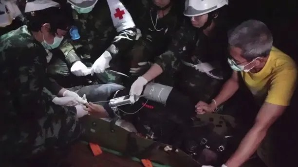 This undated photo from video released via the Thai NavySEAL Facebook Page on Wednesday, July 11, 2018, shows rescuers hold an evacuated boy inside the Tham Luang Nang Non cave in Mae Sai, Chiang Rai province, in northern Thailand. A daring rescue mission in the treacherous confines of a flooded cave in northern Thailand has saved all 12 boys and their soccer coach who were trapped deep within the labyrinth, ending a grueling 18-day ordeal that claimed the life of an experienced volunteer diver and riveted people around the world. (Thai NavySEAL Facebook Page via AP)