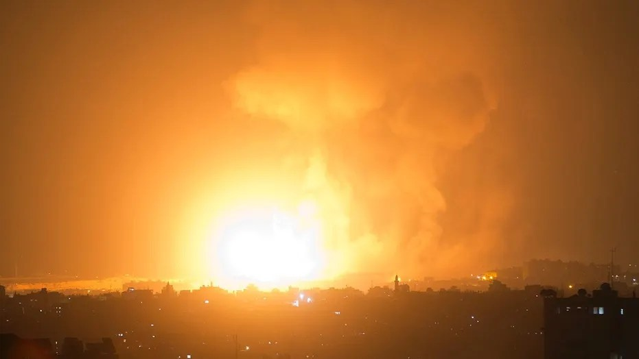 An explosion caused by Israeli airstrikes on Gaza City, early Thursday, Aug. 9, 2018.