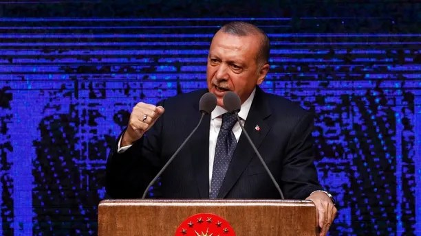 Turkey's President Recep Tayyip Erdogan announces plan of action for the first 100 days of his new presidency, in Ankara, Turkey, Friday, Aug. 3, 2018. (AP Photo/Burhan Ozbilici)