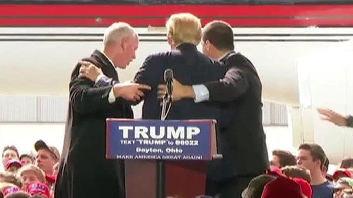 Agents rush stage at Trump rally