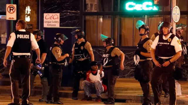 Peaceful demonstrations erupt into violence over white cop's acquittal in shooting death of black man