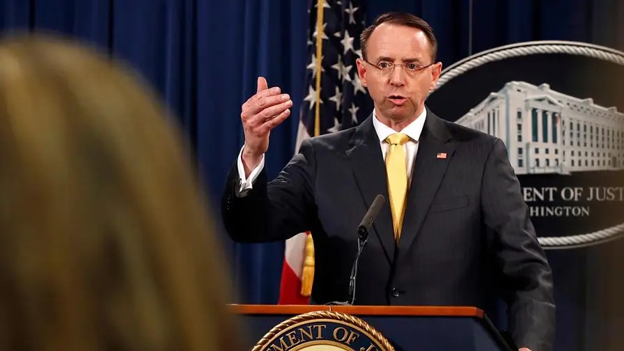 Deputy Attorney General Rosenstein says the defendants posed as politically and socially active Americans to engage in informational warfare during presidential election and the early days of the Trump administration; no allegation in indictment that any American had knowledge of Russian activities.