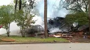 Gas explosion occurs after a car crashes into a home in Texas.