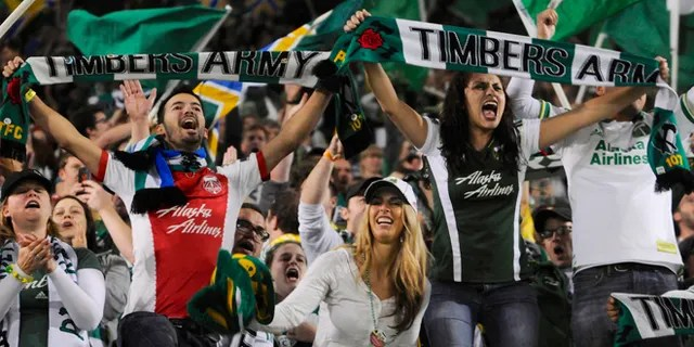 Portland Timbers fans celebrate the win against Seattle in an MLS Soccer game in Portland, Ore, on Oct. 13, 2013. (Associated Press)