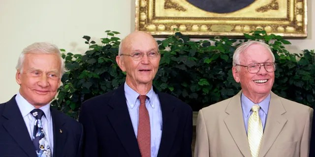 In this July 20, 2009, photo, Buzz Aldrin, left, Michael Collins, center, and Neil Armstrong stand in the Oval Office at the White House in Washington, on the 40th anniversary of the Apollo 11 moon landing.