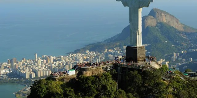 An aerial view of the 'Christ the Redeemer' statue on top of Corcovado mountain on July 27, 2011 in Rio de Janeiro, Brazil.