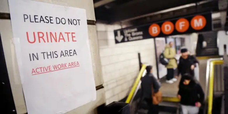 "A sign in the West 4th Street subway station reads ""Please Do Not Urinate In This Area - Active Work Area,"" Tuesday, March 3, 2015, in New York. (AP Photo/Mark Lennihan)"